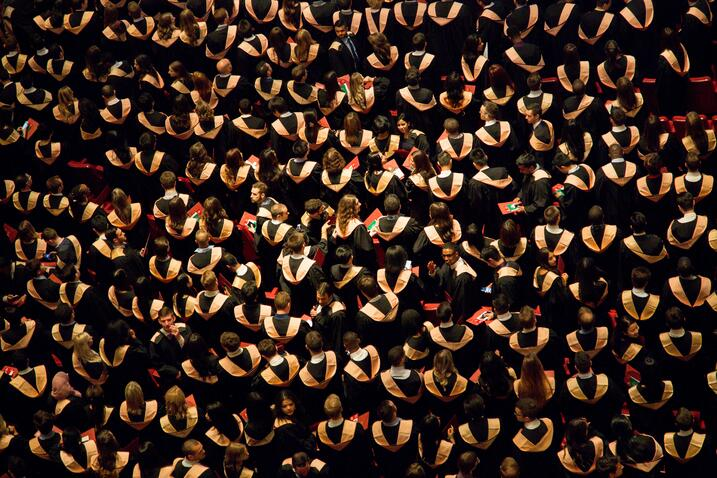 Aerial shot of a large crowd of college graduates at a ceremony